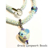 LC- Necklace with 11808305 Light Ivory w/Blue Flower Heart