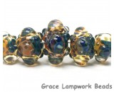 10409411 - Five Graduated Blue & Orange Boro Rondelle Beads