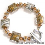 10303404 Bracelet using Ivory w/Crystal Clear Pillow Beads