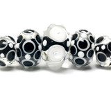 10202111 - Five Graduated Black & White Rondelle Beads