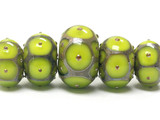 10505011 - Five Pear Green w/Metal Dots Graduated Rondelle Beads