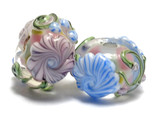 11005401 - Seven Light Pink w/Blue Floral Rondelle Beads