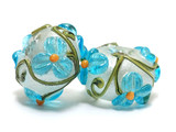 10411301 - Seven Maya Blue Flower Rondelle Beads