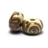 11101001 - Seven Ivory w/Beige Stringer Rondelle Beads