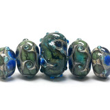 10406511 - Five Graduated Deep Ocean Blue w/Silver Foil Beads