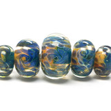 10409311 - Five Graduated Blue & Orange Rondelle Beads
