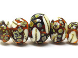11102411- Five Graduated Dark Brown w/Ivory Silver Beads