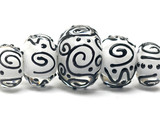 10202311 - Five Graduated Black & White Rondelle Beads