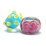 10107701 - Seven Blue w/Pink Flower Rondelle Beads