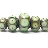 10504911 - Five Moss Green w/Metal Dots Graduated Rondelle Beads