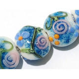 11200502 - Seven Blue w/Pink Raised Flower Lentil Beads