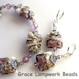 10203104 Bracelet and Earrings using Amethyst/White Pillow Beads
