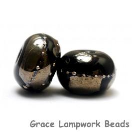 10204101 - Seven Elegant Black Metallic Rondelle Beads