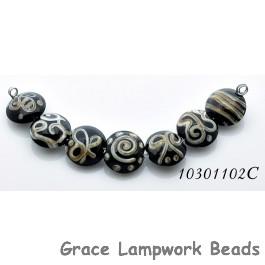 10301102C - Seven Black w/Silver Ivory String Lentil Beads