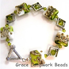 10406404 Bracelet using Lime Green w/Ivory Pillow Beads