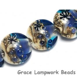 10407102 - Seven Transparent Blue Seashell Lentil Beads