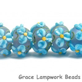 10411101 - Seven Blue Floral on Frosted Glass Rondelle Beads