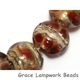 10703802 - Seven Transparent Red w/Silver Foil Lentil Beads