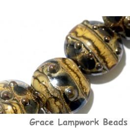 10800802 - Seven Black w/Yellow Silver Foil Lentil Beads
