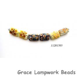 11201503 - Six Dark Yellow w/Silver Stringers Mini Kalera Beads