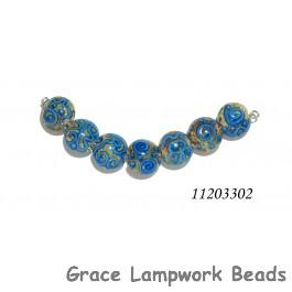 11203302 - Seven Ivory w/Blue Swirl Lentil Beads