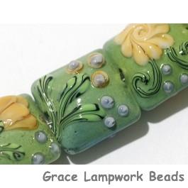 11203904 - Seven Green w/Brown & Purple Flower Pillow Beads