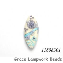 11808301 - Light Ivory w/Blue Flower Oval Focal Bead