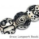 10202302 - Seven Black & White Lentil Beads