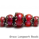 10706711 - Five Passion Pink Shimmer Graduated Rondelle Beads
