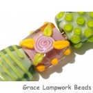 11001704 - Seven Pink/Orange/Green Tile Beads