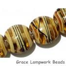 11106102 - Seven Transparent Brown w/Beige Strips Lentil Beads