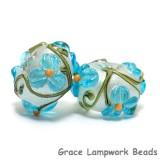 10411301 - Seven Maya Blue Flower Rondelle Beads