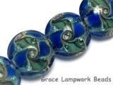 10406512 - Four Deep Ocean Blue w/Silver Foil Lentil Beads