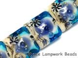 10407104 - Seven Transparent Blue Seashell Pillow Beads