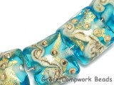 10409914 - Four Aqua Treasure Pillow Beads