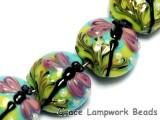 10504402 - Seven Purple Dragonfly Lentil Beads