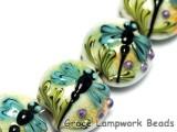 10504602 - Seven Blue Dragonfly Lentil Beads