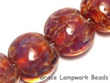 10602102 - Seven Yellow-orange & Purple Free Style Lentil Beads
