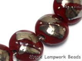 10704202 - Seven Regal Red Metallic Lentil Beads