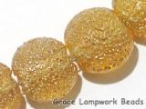 10801202 - Seven Golden Yellow Metallic Lentil Beads