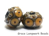 10801301 - Seven Butterscotch w/Metal Dots Rondelle Beads