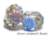 11005401 - Seven Light Pink w/Blue Floral Rondelle Beads