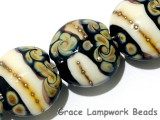 11105012 - Four Black/Ivory & Beige Lentil Beads