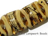 11106104 - Seven Transparent Brown w/Beige Strips Pillow Beads