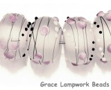 10109641-Eight Champagne Party Rondelle Lampwork Beads