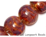 10601602 - Seven Orange  & Purple Lentil Beads