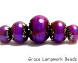 10604011 - Five Violet Shimmer Graduated Rondelle Beads