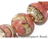 10704302 - Seven Pink/Soft Orange Lentil Beads