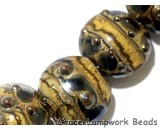 10800802 - Seven Black w/Yellow Silver Foil Lentil Beads
