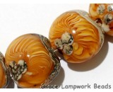 10801912 - Four Amber Wave Lentil Beads
